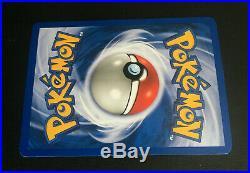1st Edition Suicune 14/64 Holo Neo Revelation Pokemon Card