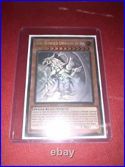 Yugioh ghost rare winged dragon of ra led7-en000 1st edition